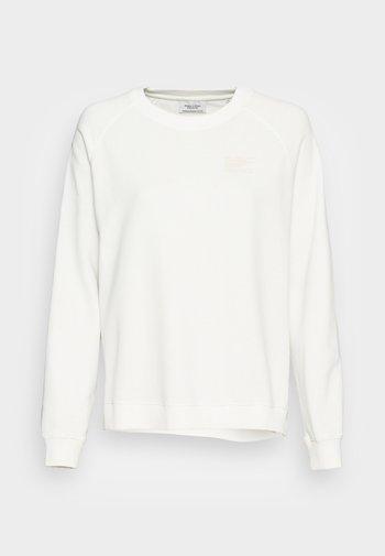 RAGLAN LONGSLEEVE SLITS AT SIDESEAM CHEST PRINT - Sweatshirt - scandinavian white
