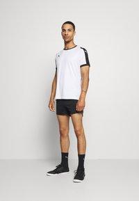 Puma - Sports shorts - black/asphalt - 1