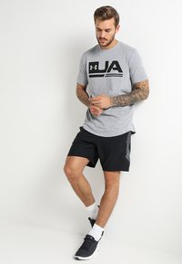 Under Armour - GRAPHIC SHORTS - Urheilushortsit - black/steel - 1