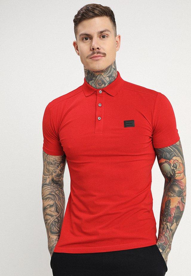 SPORT PLAQUETTE - Polo shirt - rosso