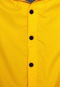 Petit Bateau - CAPE DE PLUIE UNISEX - Waterproof jacket - jaune - 2