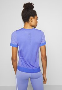 Nike Performance - INFINITE - Print T-shirt - sapphire/light thistle - 2