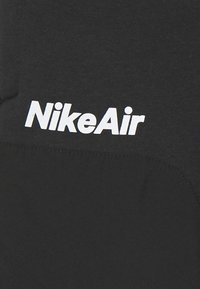 Nike Sportswear - AIR UNISEX - Tracksuit bottoms - black - 2