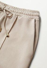 Mango - FLORIDA - Teplákové kalhoty - gris claro/pastel - 6