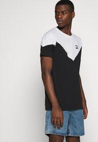 Puma - ICONIC TEE - T-shirt med print - black - 4