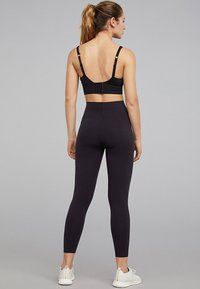 OYSHO - Sports bra - black - 1