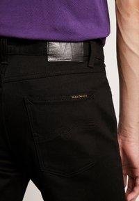 Nudie Jeans - STEADY EDDIE - Straight leg jeans - dry ever black - 5