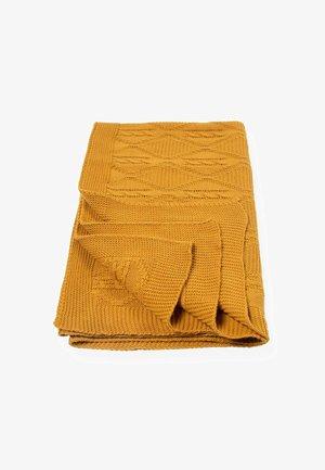 Bæresele - mustard yellow