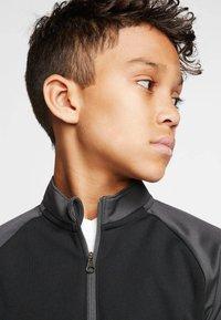 Nike Performance - Long sleeved top - schwarz/grau (718) - 3