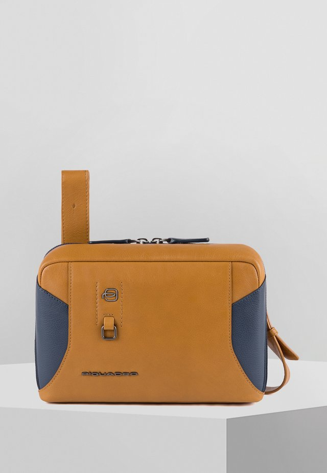 HAKONE - Bum bag - tobacco blue