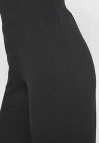 CALANDO - Tracksuit bottoms - black