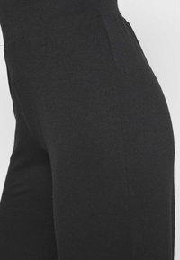 CALANDO - Teplákové kalhoty - black - 4