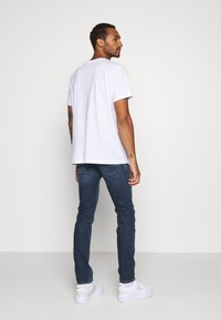 Diesel - THOMMER-X - Slim fit jeans - 009da - 2