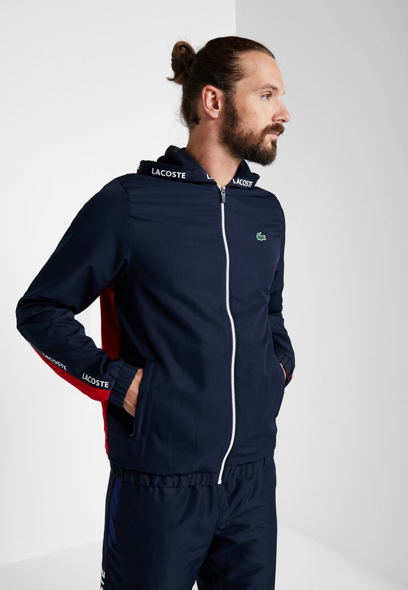 Lacoste Sport - Training jacket - navy blue/red/navy blue/white