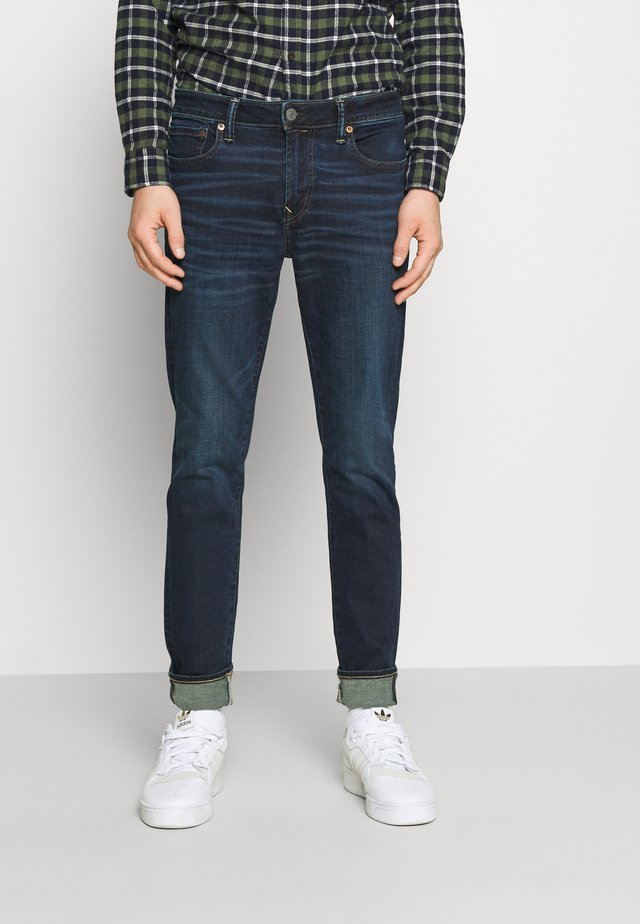 CLEAN - Slim fit jeans - dark wash