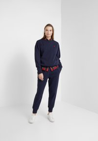 Polo Ralph Lauren - SEASONAL - Pantalones deportivos - cruise navy - 1