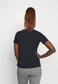 Champion - CREWNECK LEGACY - Print T-shirt - navy - 2