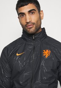 Nike Performance - NIEDERLANDE KNVB  - Training jacket - black/safety orange - 5