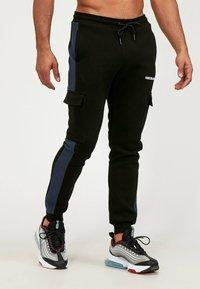 Kings Will Dream - Cargo trousers - black/navy - 4