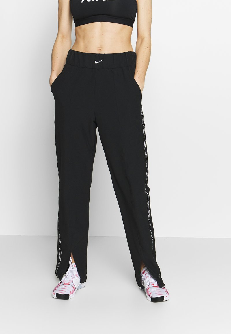 Nike Performance - PANT - Tracksuit bottoms - black/metallic silver