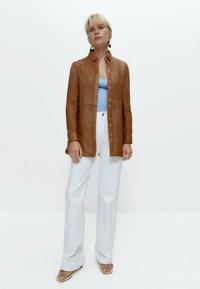 Uterqüe - Leather jacket - brown - 1
