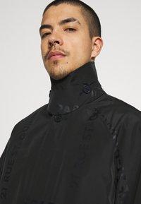 KARL LAGERFELD - UNISEX - Waterproof jacket - black - 5