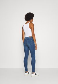 Vero Moda - VMTANYA PIPING - Jeans Skinny Fit - dark blue denim