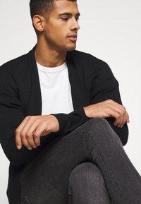 AllSaints - CIGARETTE - Jeans Skinny Fit - washed black - 3