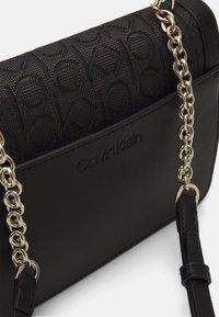 Calvin Klein - FLAP SHOULDER BAG - Across body bag - black - 3