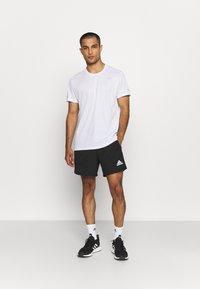 adidas Performance - OWN THE RUN - Sportovní kraťasy - black - 1