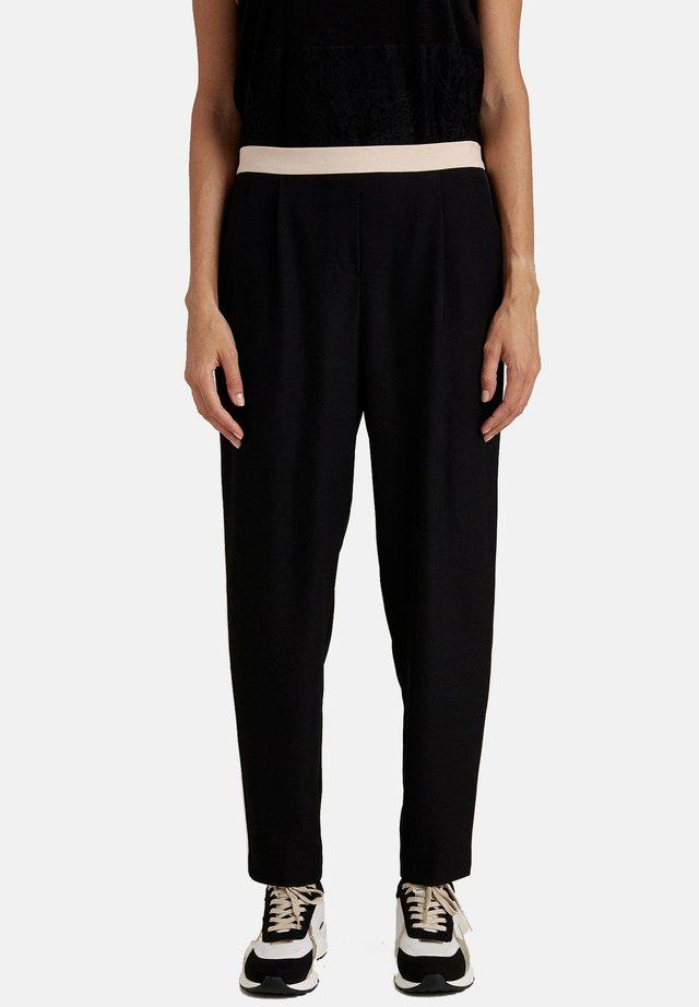 CARROT CON PROFILI A CONTRASTO - Pantalones - nero