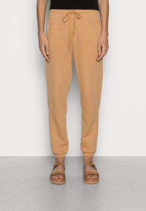 GRAPH PAPER - Tracksuit bottoms - dried straw