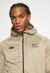 Nike Sportswear - HOODIE - Training jacket - khaki/black/white