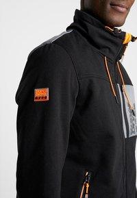 Superdry - ATOMIC WINDTREKKER - Summer jacket - black/bright orange - 4