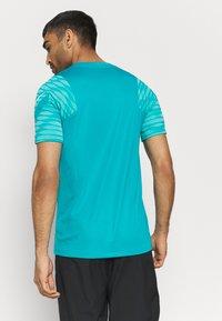 Nike Performance - Print T-shirt - aquamarine/tropical twist/white - 2