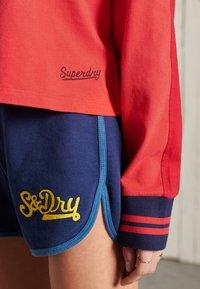Superdry - COLLEGIATE GRAPHIC - Long sleeved top - drop kick red - 1