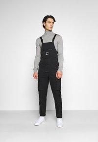 Nike Sportswear - OVERALLS - Trousers - black/white - 0