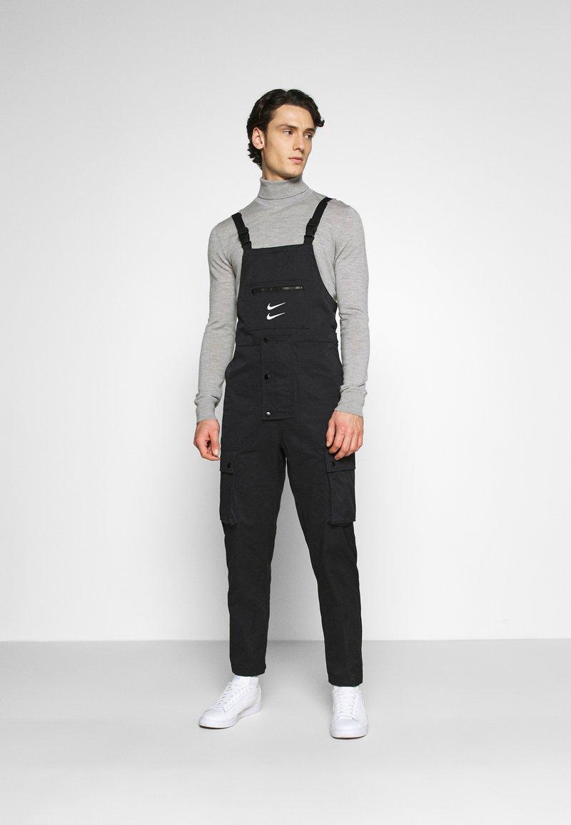Nike Sportswear - OVERALLS - Trousers - black/white