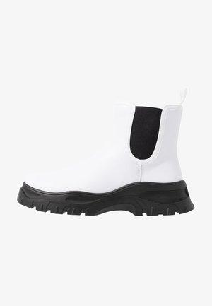 SASHA - Platform ankle boots - white/black