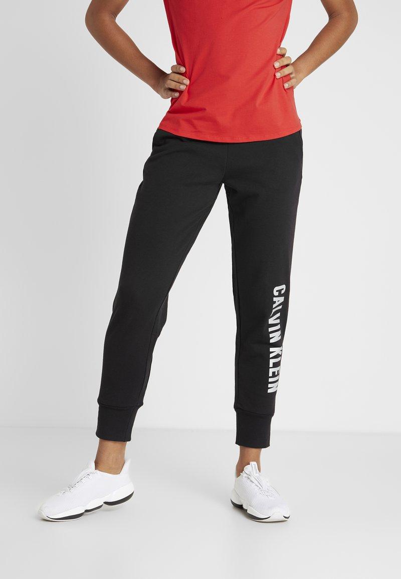 Calvin Klein Performance - PANTS - Verryttelyhousut - black