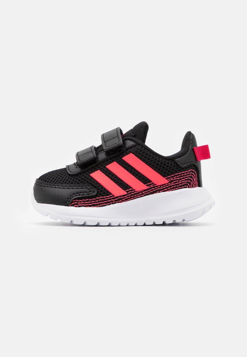 adidas Performance - TENSAUR RUN UNISEX - Chaussures de running neutres - core black/signal pink/power pink