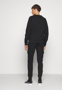CLOSURE London - UTILITY JOGGER - Spodnie treningowe - black - 2