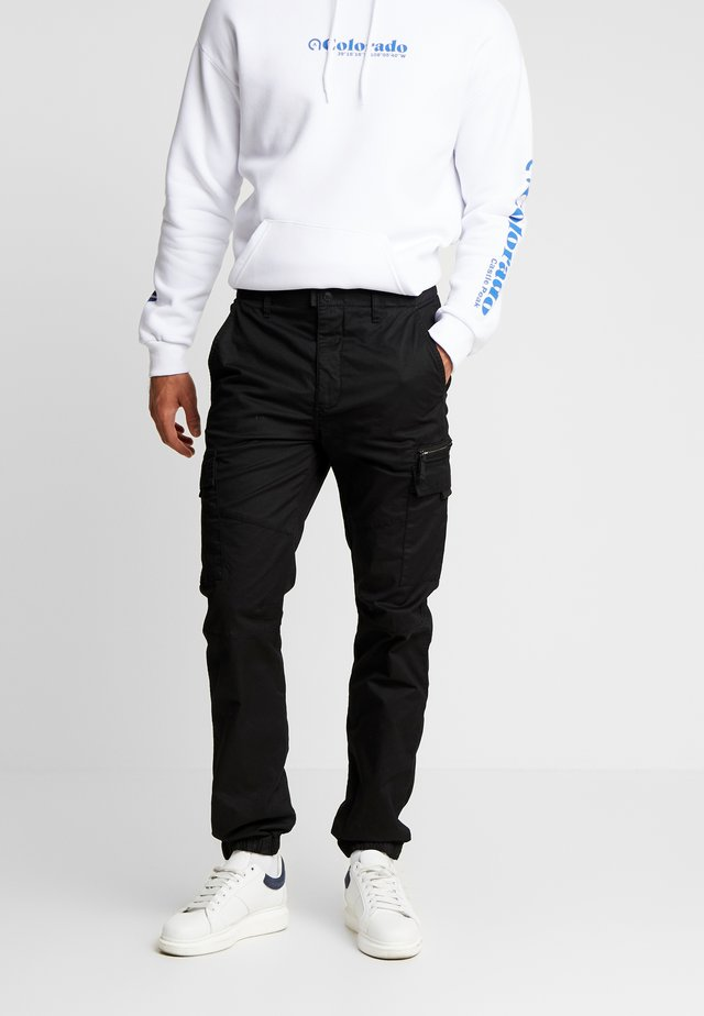 TRTECH - Cargo trousers - black