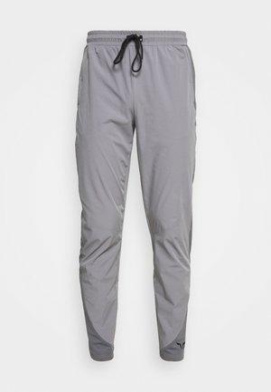 LIMITLESS TRACK PANTS - Träningsbyxor - grey