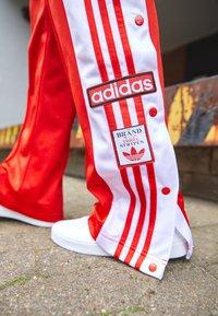 adidas Originals - ADIBREAK - Pantalones deportivos - red - 2