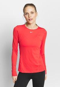 Nike Performance - ALL OVER - Koszulka sportowa - track red/white - 0
