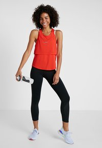 Nike Performance - TANK BREATHE - Sports shirt - bright crimson/reflective silver - 1