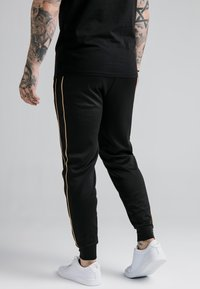 SIKSILK - ASTRO CUFFED TRACK PANTS - Trainingsbroek - black/gold - 2