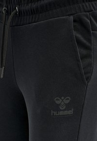 Hummel - Tracksuit bottoms - black - 3
