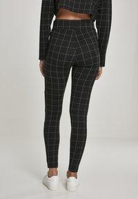 Urban Classics - Leggings - Trousers - black/white - 2